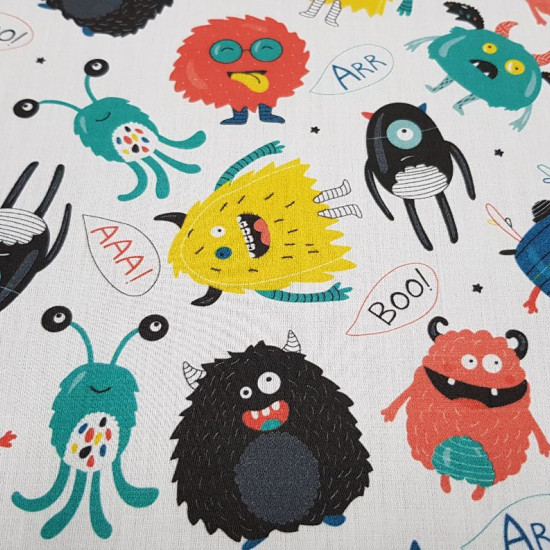 Tela Algodón Monstruitos Graciosos - Tela de algodón satinada con dibujos de monstruos y personajes graciosos tipo viñeta de cómic sobre un fondo blanco. La tela mide 140cm de ancho y su composición 100% algodón.