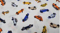 Cotton Cars Colors fabric - Cotton fabric with drawings of cars of various colors on a white background. The fabric is 150cm wide and its composition is 100% cotton.