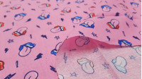Cotton Tongues Rays fabric - Poplincotton fabric with mouth patterns with the tongue hanging out and decorated with stars, rays and other symbols on a pink background. The fabric is 145cm wide and its composition is 100% cotton.