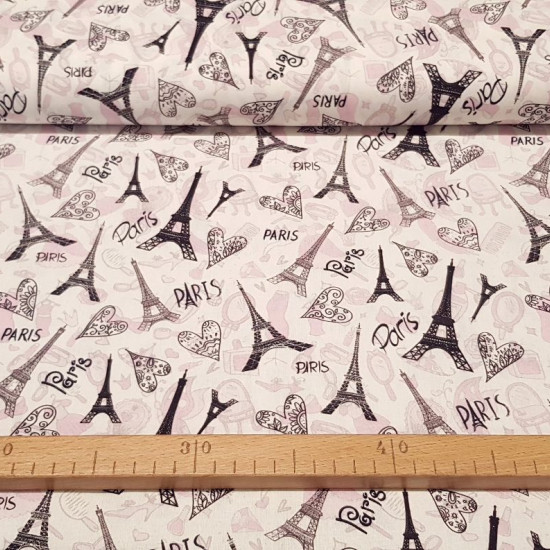 Cotton Paris Eiffel Tower Love fabric - Cotton fabric with drawings of the famous Paris Eiffel Tower on a boutique background. Hearts and letters with the name of the city of Paris also appear. The fabric is 150cm wide and its composition is 100% cotton