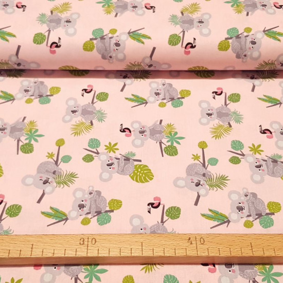 Cotton Koalas and Toucans fabric - Children's cotton fabric with drawings of koalas on tree branches and toucans on a soft pink background. A gorgeous fabric! The fabric is 140cm wide and its composition is 100% cotton.