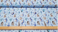 Cotton Funny Sharks fabric - Children's cotton fabric with drawings of sharks and other fishes on a light blue background decorated with small waves. The fabric is 140cm wide and its composition is 100% cotton.