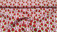 Cotton Strawberry Mosaic fabric - Cotton fabric with drawings of strawberries forming a mosaic of red and white colors. The fabric is 150cm wide and its composition is 100% cotton.