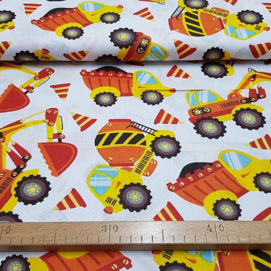 Cotton Constructions Vehicles fabric - Decorative cotton fabric with large drawings of construction and construction vehicles, such as concrete mixers, tippers, tractors... on a white background. The fabric is 160cm wide and its composition is 100% cotton