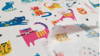 Cotton Cats Colors fabric - Satin cotton fabric with colorful cat drawings on a white background. The fabric is 140cm wide and its composition is 100% cotton.