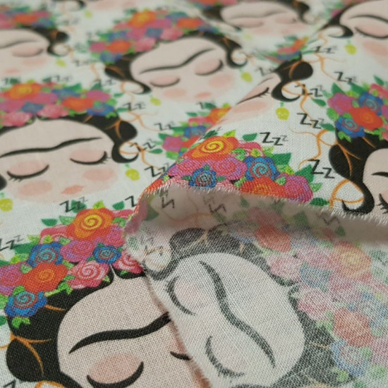 Cotton Frida Dreams fabric - Cotton fabricdigital printing with children's drawings of Frida Kahlo dreaming on a white background. The fabric is 140cm wide and its composition is 100% cotton.