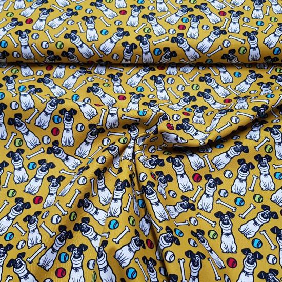 Tela Algodón Mascotas Max Mostaza - Tela de algodón licencia Universal Pictures con dibujos del perrito Max de la película Mascotas sobre un fondo color mostaza con huesos y pelotas de colores. La tela mide 150cm de ancho y su composición 100% algodón.