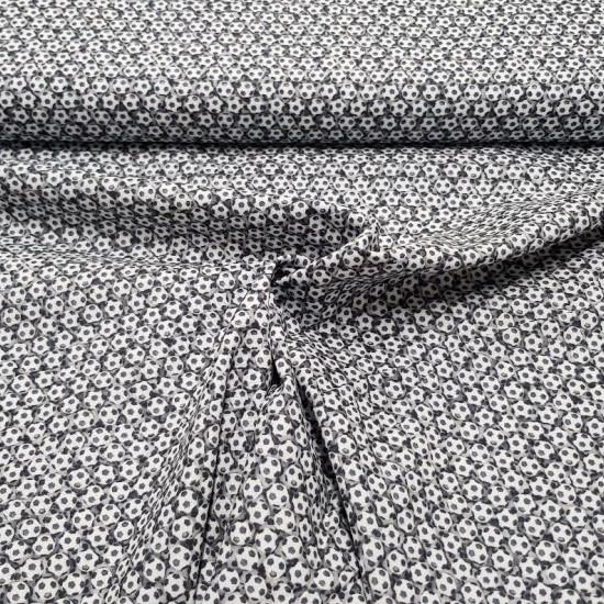 Tela Algodón Pelotas Fútbol - Tela de algodón con dibujos pequeños de pelotas de fútbol. La tela mide 150cm de ancho y su composición 100% algodón.