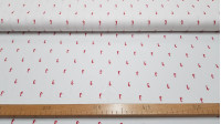 Fine Cotton Seahorses fabric - Cotton fabric with small red seahorse drawings on a white background. The fabric is 150cm wide and its composition is 100% cotton.