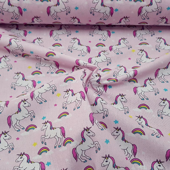 Cotton Unicorn Stars Pink fabric - Digital printed children's cotton fabric with drawings of unicorns, rainbows and stars on a pink background. The fabric is 150cm wide and its composition is 100% cotton.