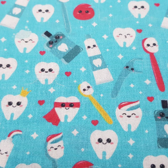 Cotton Smiling Teeth fabric - Digital printing cotton fabric with fun drawings of teeth, brushes, mouthwash... on a turquoise blue background. The fabric is 140cm wide and its composition is 100% cotton.