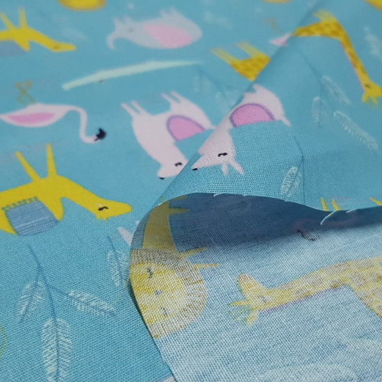 Cotton Animals Desert fabric - Children's cotton fabric with drawings of animals such as lions, elephants, camels, crocodiles... on a lightbackground. Ideal for children's creations such as baby lullabies. The fabric is 150cm wide an