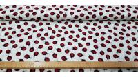 Tela Algodón Mariquitas - Tela de algodón con dibujos de mariquitas sobre un fondo blanco. La tela mide 140cm de ancho y su composición 100% algodón.