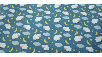 Cotton Sheep Clouds fabric - Cotton fabric with drawings of sheep and clouds on a background with stars and moons. The fabric is 150cm wide and its composition is 100% cotton.
