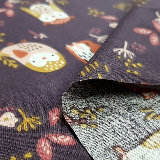 Cotton Foxes Birds Violet fabric - Children's cotton fabric with drawings of birds, owls and foxes on a dark purple background in contrast to ocher, orange, pink... The fabric is 150cm wide and its composition is 100% cotton.