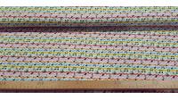 Tela Algodón Notas Musicales Colores - Tela de algodón con dibujos de notas musicales sobre un fondo multicolor. La tela mide 150cm de ancho y su composición 100% algodón