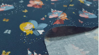 Cotton Fairy Princesses Fabby fabric - Organic cotton fabric (GOTS) with drawings of fairy princesses with magic wands on a dark blue background with butterflies and castles. The fabric is 150cm wide and its composition is 100% cotton.