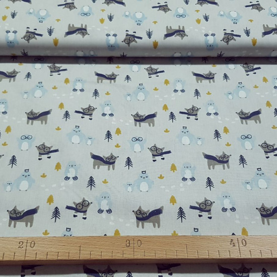 Cotton Wolves and Penguins fabric - Cotton fabric with children's drawings of wolves with scarf and glasses, funny penguins with crowns on a gray background with gold and blue trees. The fabric is 150cm wide and its composition is 100% cotton.