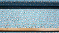 Cotton Teeth Stars fabric - Cotton fabric with drawings of funny teeth on a blue background with stars. The fabric is 150cm wide and its composition is 100% cotton.