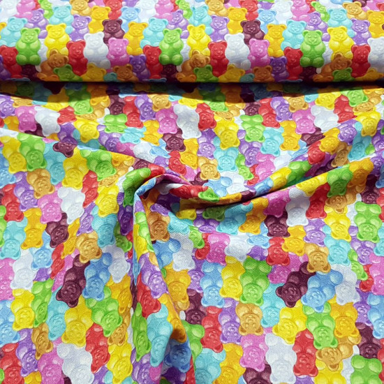Cotton Gummy Bears fabric - Cotton fabric with drawings of colored gummy bears. The fabric is 150cm wide and its composition is 100% cotton.