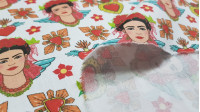 Cotton Frida Winged Hearts fabric - Satin cotton fabric with Frida drawings and winged hearts on a white background. The fabric is 140cm wide and its composition is 100% cotton.