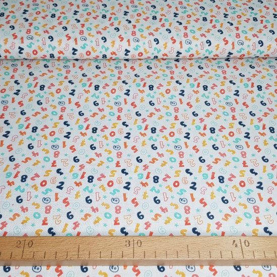 Cotton Numbers Colors fabric - Organic cotton poplin (GOTS) fabric with colored number patterns on a white background. The fabric is 150cm wide and its composition is 100% cotton.