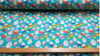 Cotton Cupcakes Multicolor fabric - Poplin cotton fabric with colorful cupcake drawings on a turquoise green background. The fabric is 150cm wide and its composition is 100% cotton.