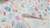 Cotton Jellyfish Seahorses fabric - Poplin cotton fabric with drawings of seahorses, jellyfish and marine corals on a white background. The fabric is 150cm wide and its composition is 100% cotton.
