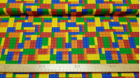 Cotton Blocks Construction Colors fabric - Poplin cotton fabric patterned with colorful building blocks toy, which reminds us to the famous Lego®. The fabric is 150cm wide and its composition is 100% cotton.