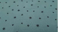 Washed Cotton Stars Dusty Mint fabric - Lightly wrinkled, washed effect children's cotton fabric with star patterns in black lines on a dusty mint green background. The fabric is 135cm wide and its composition is 100% cotton.
