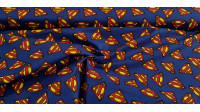 Cotton Superman Logos Blue fabric - Cotton fabric with drawings of logos of the superhero Superman on a blue background. The fabric is 110cm wide and its composition 100% cotton