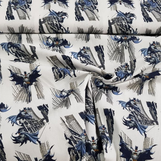 Cotton Batman City fabric - Cotton fabric of the superhero Batman in several shots running through the city on a white background. The fabric is 150cm wide and its composition is 100% cotton.