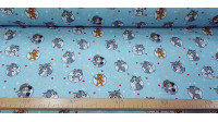 Tela Algodón Tom Jerry Topos - Tela de algodón licencia con dibujos de los personajes clásicos Tom y Jerry sobre un fondo de color azul con topos de colores. La tela mide 140cm de ancho y su composición 100% algodón