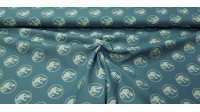 Cotton Jurassic Logos Green fabric - Cotton fabric with drawings of Jurassic Park logos on a petrol green background. The fabric is 150cm wide and its composition is 100% cotton.