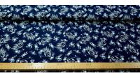 Tela Algodón Spirit Caballo Floral Marino - Tela de algodón licencia Dreamworks con dibujos en trazos blancos del caballo Spirit sobre un fondo azul marino adornado con flores. La tela mide 150cm de ancho y su composición 100% algodón.