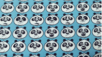 Cotton Kung Fu Panda Faces fabric - Dreamworks licensed cotton fabric with drawings of faces of the character Po from the movie Kung Fu Panda on various colored backgrounds. The fabric is 150cm wide and its composition is 100% cotton.