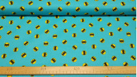 Cotton Batman Circular Turquoise Logo fabric - Licensed cotton fabric with drawings of the Batman logo in circular format on a turquoise background. The fabric is 110cm wide and its composition is 100% cotton.