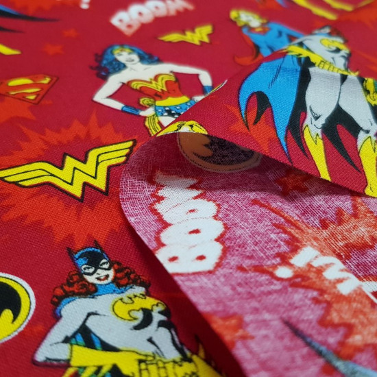 Cotton Heroines DC Comic Red fabric - Licensed cotton fabric with drawings of DC Comics superheroines (Wonder Woman, Catgirl and Supergirl) on a dark red background with onomatopoeias and stars. The fabric is 110cm wide and its composition is 100% cotton
