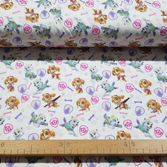 Cotton Paw Patrol Skye Everest fabric - Licensed cotton fabric with drawings of the Paw Patrol characters, Skye and Everest on a white background with shields, bones and footprints. The fabric is 150cm wide and its composition is 100% cotton.