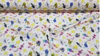 Cotton Trolls Rainbow Hearts fabric - Licensed cotton fabric with drawings of the Trolls characters on a white background with hearts, rainbows. The fabric is 150cm wide and its composition is 100% cotton.