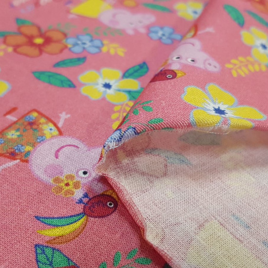 Cotton Peppa Pig Summer Flowers fabric - Licensed cotton fabric with drawings of Peppa Pig with a very striking flowery background and phrases