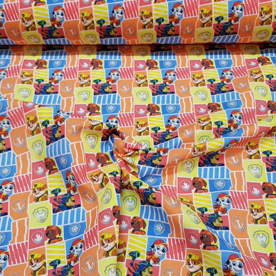 Cotton Paw Patrol Shields fabric - Licensed cotton fabric with drawings of the Paw Patrol characters on a background of colored frames and shields. The fabric is 150cm wide and its composition is 100% cotton.