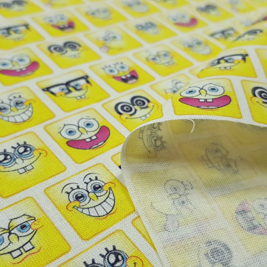 Cotton Spongebob Square Emoticons fabric - Licensed cotton fabric with drawings of emoticons in square shapes with the faces of SpongeBob SquarePants. The fabric is 150cm wide and its composition is 100% cotton.