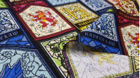 Cotton Harry Potter Stained Glass fabric - Licensed cotton fabric with colorful stained glass drawings representing the different Hogwarts houses from the Harry Potter saga. The fabric is 110cm wide and its composition is 100% cotton.