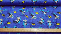 Cotton Batman Comic Background fabric - Licensed cotton fabric with drawings of the Batman character and logos on a bluish background with comic motifs. The fabric is 110cm wide and its composition is 100% cotton.