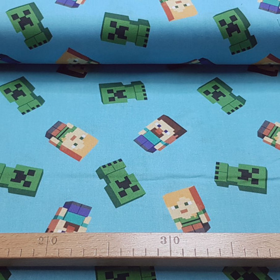 Cotton Minecraft Characters fabric - Licensed cotton fabric with drawings of various characters from the Minecraft video game, on a blue background. The fabric is 110cm wide and its composition is 100% cotton.