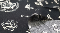 Cotton Harry Potter Hogwarts Badges fabric - License cotton fabric with drawings of Hogwarts badges and other Harry Potter objects, on a black background. The fabric is 110cm wide and its composition is 100% cotton.