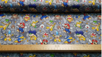 Cotton Super Mario Villains fabric - Licensed cotton fabric with drawings of the villainous characters from the video game Super Mario, on a gray background. The fabric is 110cm wide and its composition is 100% cotton.