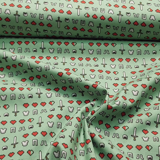 Cotton Minecraft Symbols Emojis fabric - Licensed cotton fabric with drawings of symbols and emojis from the Minecraft video game on a green background. The fabric is 110cm wide and its composition is 100% cotton.