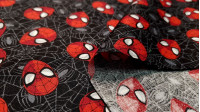 Cotton Marvel Spiderman Masks fabric - License cotton fabric with drawings of the Spiderman character masks on a black background with cobwebs. The fabric is 110cm wide and its composition is 100% cotton.